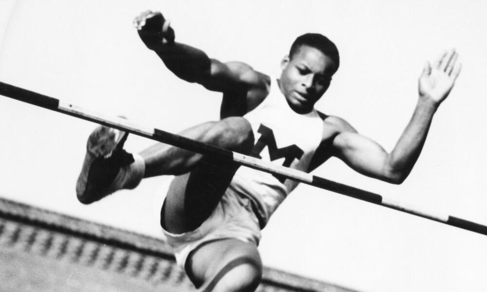 Bill Watson completing a high jump