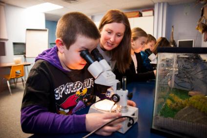 Child looking through microscope