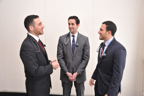 Christopher Khoury, Nicholas Cozzi, and Alexander Ghannam plan for an upcoming presentation on leadership in health care delivery