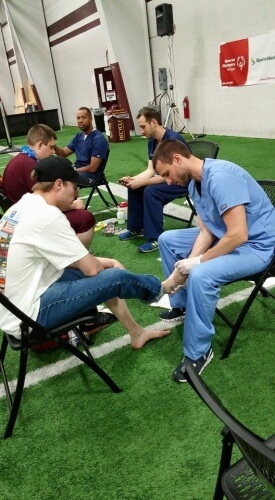 Special Olympics athletes work with Runners Athletic Company staff to find the right shoe to take home the gold